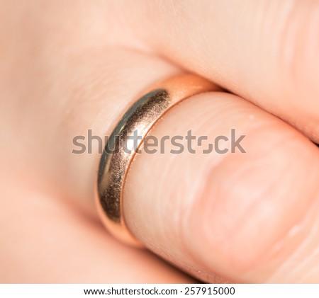 gold ring on her finger - stock photo