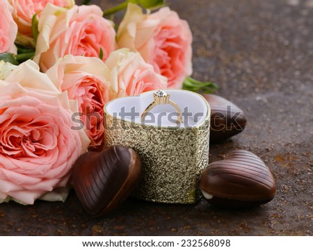 gold ring with diamond and bouquet pink roses  - stock photo
