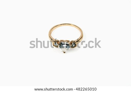 Gold ring with diamonds isolated on white background.