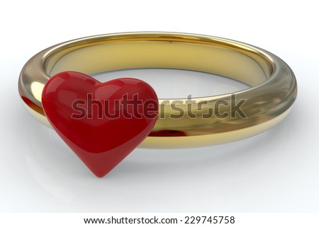 Gold ring with red heart - stock photo