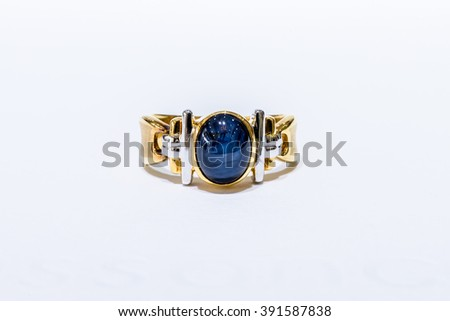 Gold ring with sapphire