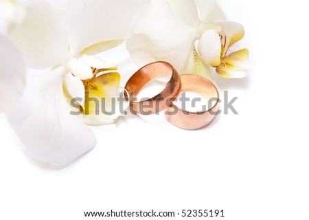 Gold rings with orchid isolated on white background - stock photo