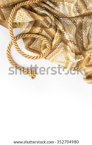 gold rope and silk on a white background