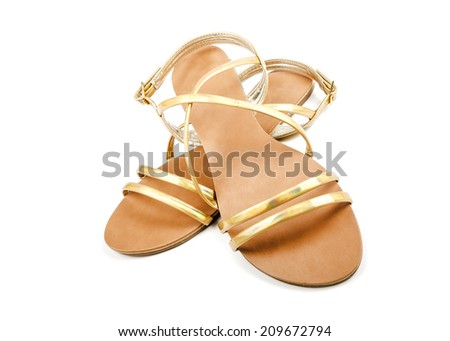 Gold sandals isolated on a white background - stock photo