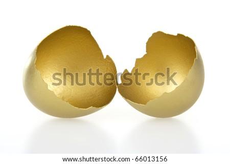 Gold shell of egg on white background. - stock photo