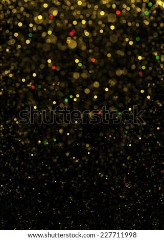 Gold sparkle glitter background. Glitter stars background. Sparkling flow background - stock photo