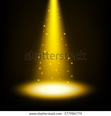 Gold spotlight shining with sprinkles - stock photo