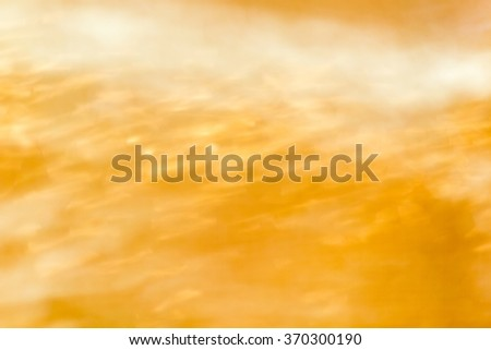 Gold spring or summer background. Elegant abstract background with defocused lights - stock photo