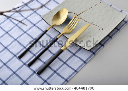 Gold stainless steel knife and fork spoon - stock photo