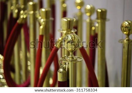 Gold stanchion posts , cinema  - stock photo