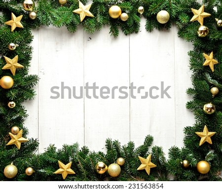 Gold star Christmas ornaments on fir leaves.Image of Christmas. - stock photo