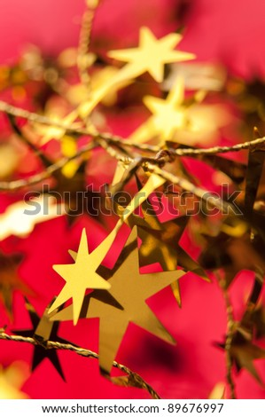 gold star on red background - stock photo