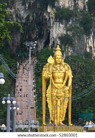 Gold statue in front of the Batu Caves in Kuala Lumpur, Malaysia - stock photo