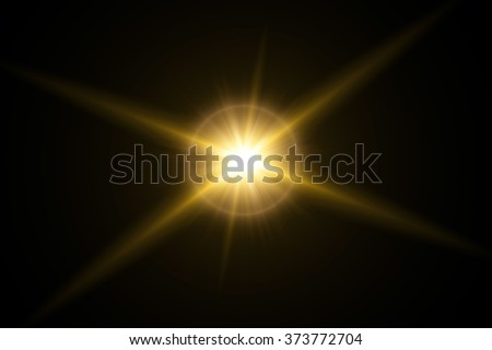 Gold sunlight flare in black background - stock photo