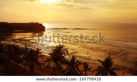 Gold sunset at low tide on Balangan beach of Bali - stock photo