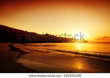 Gold sunset on the sand beach. Saychelles island. Mahe. - stock photo