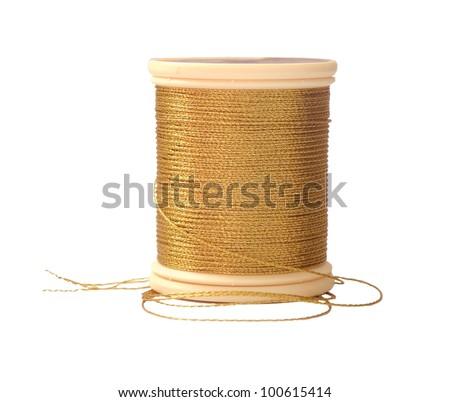 Gold Thread Spool - stock photo