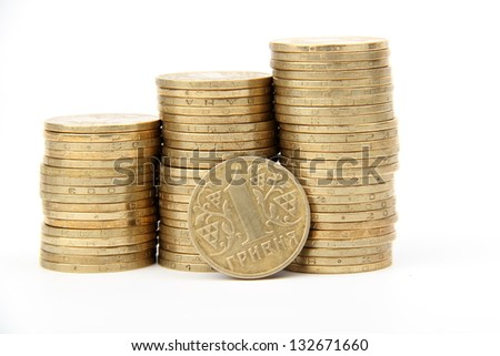 Gold towers made out of gold coins/Ukrainian coins - stock photo