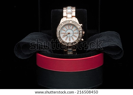 gold watch isolated on black background - stock photo
