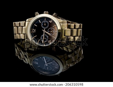 Gold watch isolated on black background with reflection  - stock photo