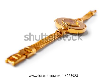 Gold watch on white background. Focus on center