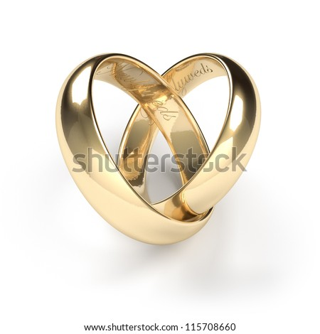 Gold wedding rings engraved with the text Newlyweds - stock photo