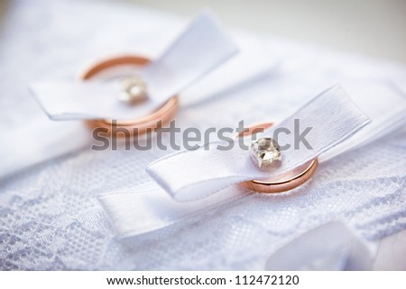 gold wedding rings on the pincushion - stock photo
