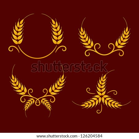 Gold wheat decoration elements on brown background - stock photo