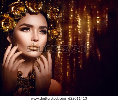 Gold Woman Holiday Makeup Beauty Fashion Model Girl With Golden Make Up Hair And