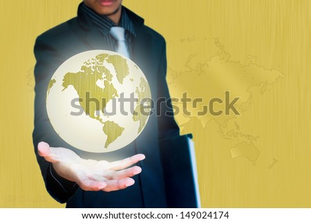 gold world in hand business background - stock photo