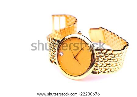 gold wrist watch - stock photo