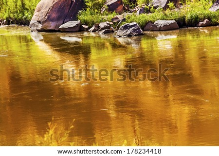 Gold Yellow Brown Colorado River Reflection Abstract Outside Arches National Park Moab Utah USA Southwest.  - stock photo