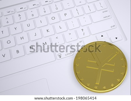 Gold yen coin on the keyboard. View from above - stock photo