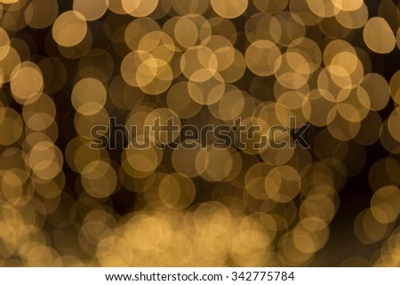 Golden abstract background with bokeh defocused lights on christmas