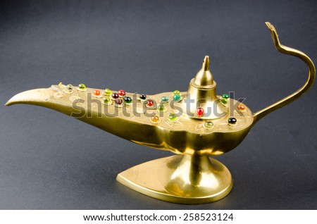 golden aladdin lamp - stock photo