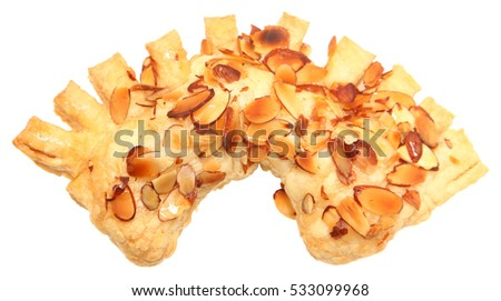 Golden Almond Honey Bear Claw Pastry isolated over white. Top view.