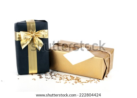 Golden and black christmas gift box  with blank card - stock photo