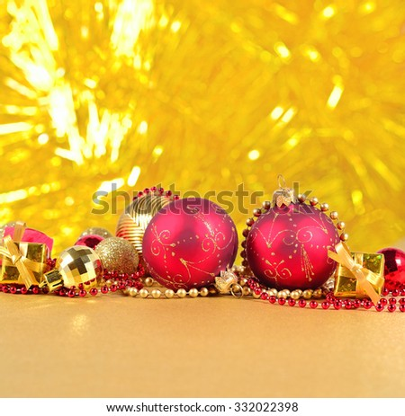Golden and red Christmas decorations on a golden background