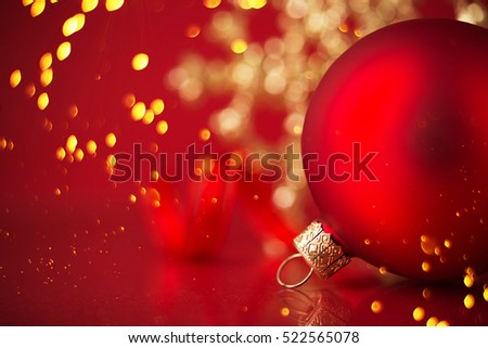 Golden and red christmas ornaments on red holiday background with twinkle bokeh light. Merry christmas card. Winter xmas theme.