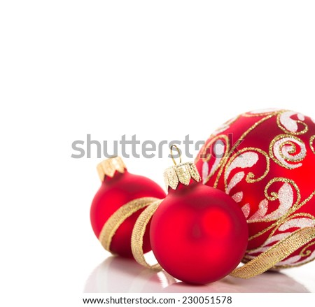 Golden and red christmas ornaments on white background with space for text. Merry christmas card. Winter holidays. Xmas theme. - stock photo