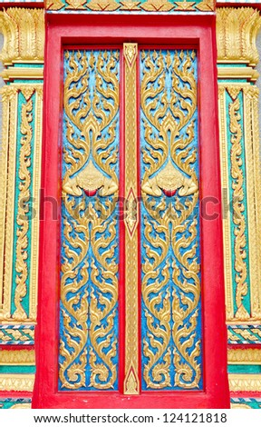 Golden and red Thai temple door sculpture - stock photo