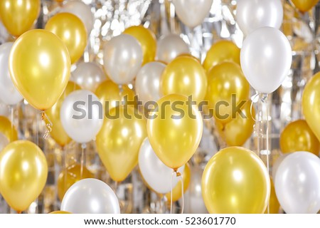Golden and silver balloons background. New Year concept