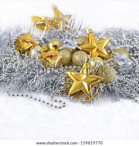 Golden and silver Christmas decorations on a white background