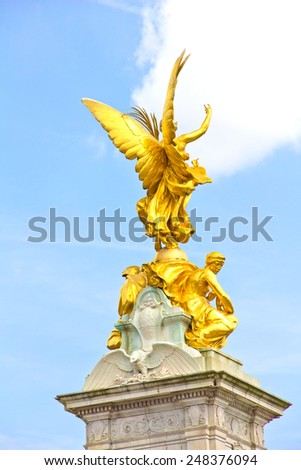 Golden angel in the Queen Victoria Memorial, Buckingham Palace, London - stock photo