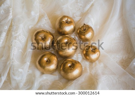 golden apples at the lace - stock photo