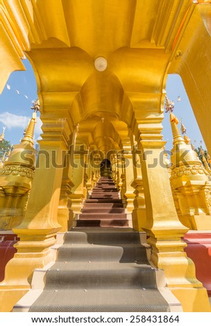 Golden arched walkway - stock photo
