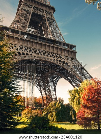 Golden autumn in Paris. Lovely park near the Eiffel Tower on the Champ de Mars.  During shooting, the color filters applied to the discretion of the author - stock photo