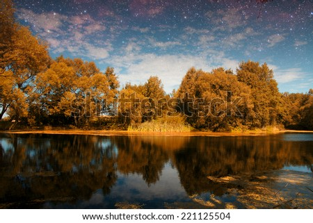golden autumn on the lake. everything was yellow in the fall. Elements of this image furnished by NASA - stock photo