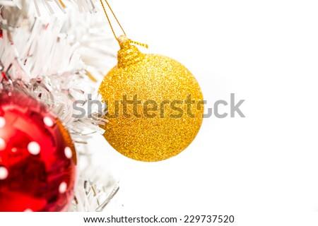 Golden ball decor on white Christmas tree - stock photo