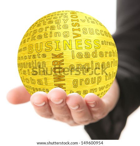 Golden ball with inscription business in a hand - stock photo